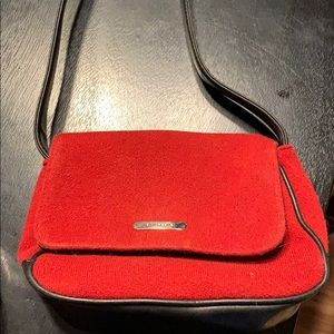 Red sweater and leather purse
